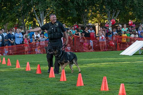 Summer evening demo for community featuring Beaverton policeman and K9 officer.