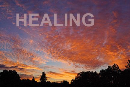 Photo of brilliant colorful sunset with the word HEALING superimposed