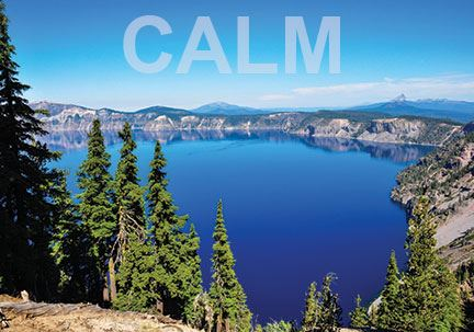 Photo of sunshine over very blue Crater Lake with word CALM superimposed.