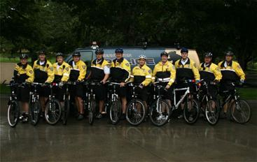 A photo of the Police Bicycle Patrol Unit in uniform with their bikes.